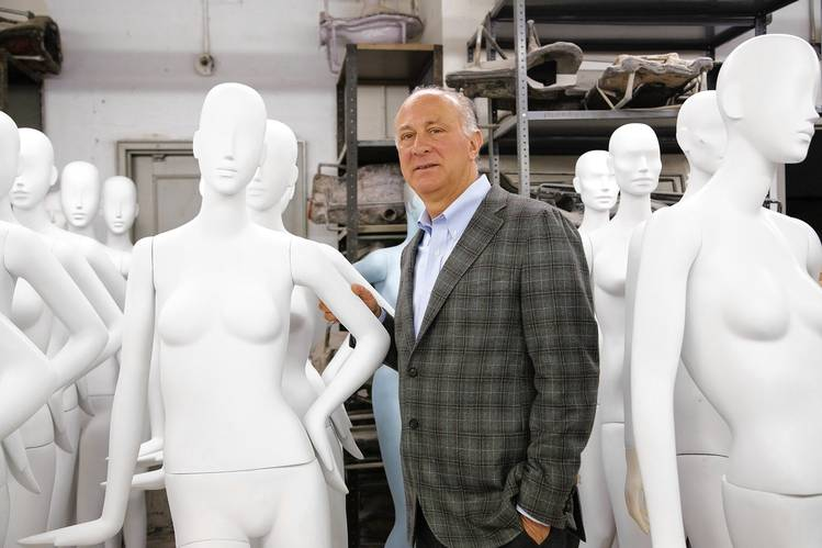 Ralph Pucci with some of his mannequins in the factory room of his Chelsea workspace.
