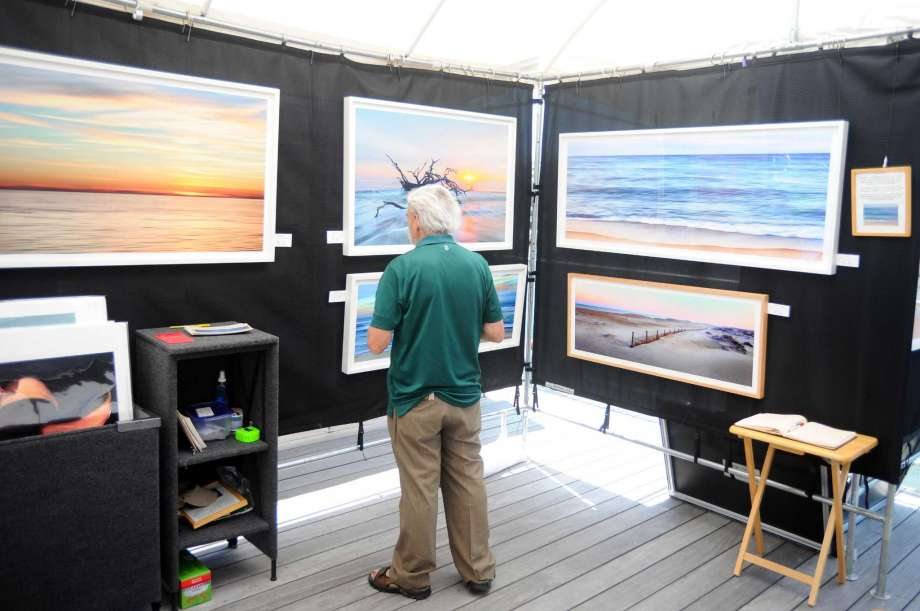 Colorful art stalls line Pacific Street in Harbor Point for the Stamford Art Festival in Stamford, Conn. on Sunday, July 30, 2017. Photo: Michael Cummo / Hearst Connecticut Media<p>Article source: <a href=