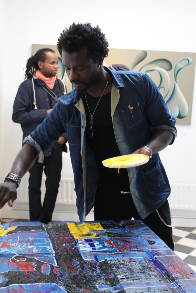 Adjani Okpu-Ekbe paints at the Knight Webb Gallery. Photograph by Ruth Waters